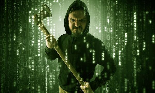 Maske, Kapuzenpulli und schwer bewaffnet: Die schönsten Stockfoto-Hacker