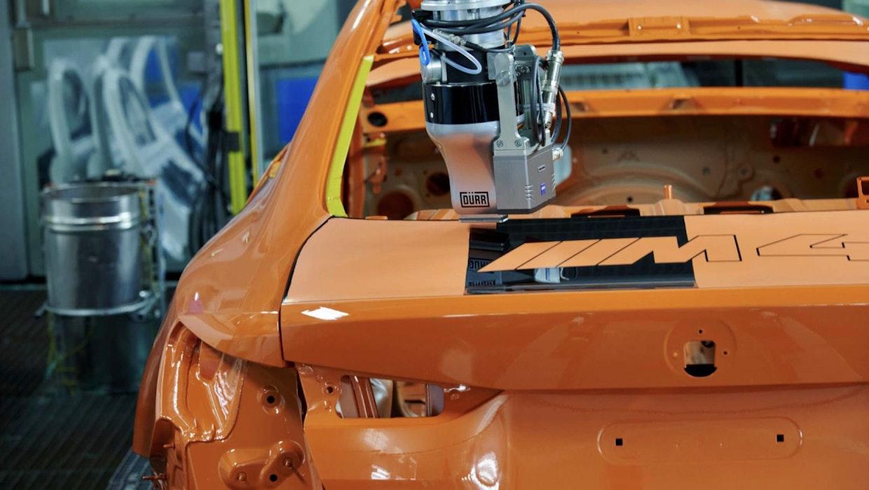 Wie riesige Tintenstrahldrucker: Bei BMW lackieren Roboter Autos jetzt punktgenau